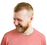 Funny man in a shirt laughs. Funny bearded man in a shirt laughs stock image