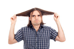 Funny man showing his long hair Royalty Free Stock Photo