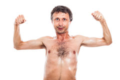 Funny man showing muscles Royalty Free Stock Images