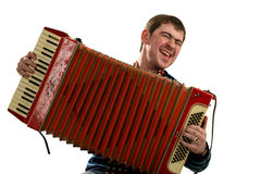 Funny man sing and play on accordion Stock Images