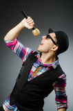 The funny man singing in karaoke. Funny man singing in karaoke Royalty Free Stock Images