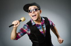 Funny man singing in karaoke Royalty Free Stock Photos