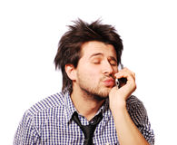 Funny man speaking mobile phone and blowing kiss Royalty Free Stock Photos