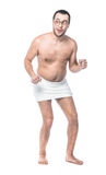 Funny man standing. Funny bare unattractive man standing after bathing. Full length of loony guy, isolated on white background Stock Images