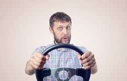 Funny man with a steering wheel, car drive concept Royalty Free Stock Images