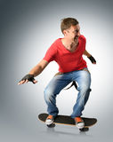 Funny man with suspender on a skateboard Stock Image