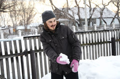 Funny man throwing a snowball Stock Images