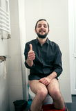 Funny man in toilet Stock Photo