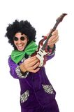 Funny man with toy guitar isolated on the white Royalty Free Stock Images
