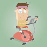 Funny man training on indoor bike trainer Royalty Free Stock Photography