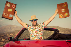 Funny man travel by car in the mountains Royalty Free Stock Images