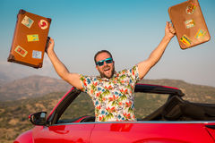 Funny man travel by car in the mountains Royalty Free Stock Image