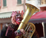 Funny man trombone player. Venice,Italy,February 26th 2011: Portrait of a funny man trombone player during a musical parade in Venice during The Carnival days Royalty Free Stock Images