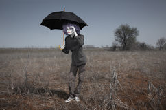 Funny man and umbrella Stock Image