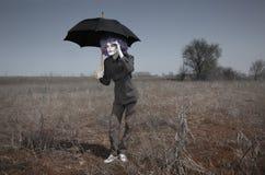 Funny man and umbrella Stock Image