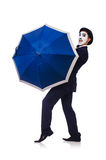 Funny man with umbrella Stock Images