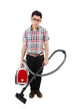 Funny man with vacuum cleaner Stock Images