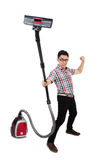 Funny man with vacuum cleaner Stock Image