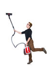 Funny man with vacuum cleaner on white Stock Photography