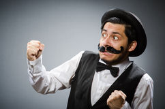 The funny man in vintage concept Stock Photos