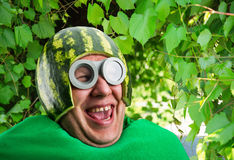 Funny man with watermelon helmet and googles. Looks like a parasitic caterpillar Stock Image