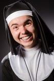 The funny man wearing nun clothing Stock Photos