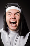 The funny man wearing nun clothing Stock Photo