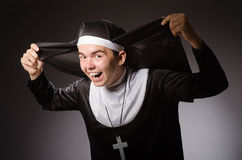 The funny man wearing nun clothing Royalty Free Stock Photo