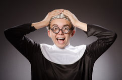 The funny man wearing nun clothing Stock Images