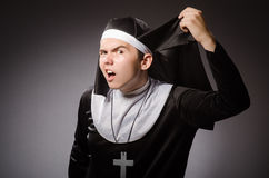 The funny man wearing nun clothing Royalty Free Stock Photography