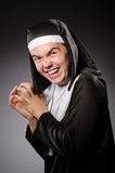 The funny man wearing nun clothing Stock Image