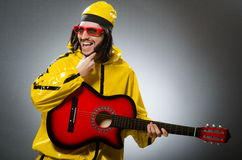 Funny man wearing yellow suit Stock Photos