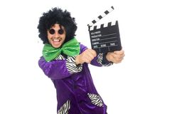 Funny man in wig with clapper board isolated on Stock Photo