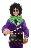 Funny man in wig with clapper board isolated on Royalty Free Stock Images