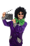 Funny man in wig with clapper board isolated on Royalty Free Stock Photos