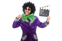 Funny man in wig with clapper board isolated on Royalty Free Stock Photo