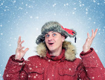 Funny Man in winter clothes enjoys the snow. Royalty Free Stock Images