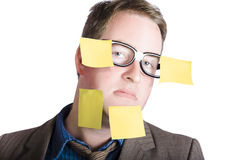 Funny man with yellow sticky notes on face Stock Photos
