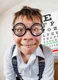 Funny manwearing spectacles in an office at the doctor Royalty Free Stock Images