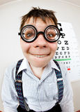 Funny manwearing spectacles in an office at the doctor Stock Image