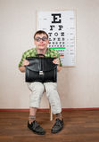 Funny manwearing spectacles in an office at the doctor Stock Photography