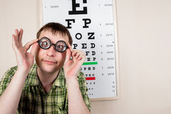 Funny manwearing spectacles in an office at the doctor Royalty Free Stock Photo