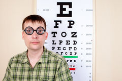 Funny manwearing spectacles in an office at the doctor Stock Photos