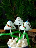 Funny marshmallows shaped as Christmas fir trees and a snowman on sticks. Royalty Free Stock Images