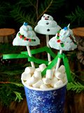 Funny marshmallows shaped as Christmas fir trees and a snowman on sticks. Stock Image