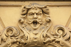 Funny mascaron on the Art Nouveau building Stock Images