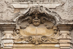Funny mascaron on the Art Nouveau building Royalty Free Stock Images