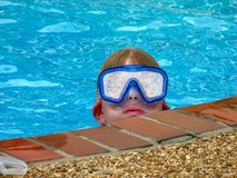Funny mask. Child in a pool Stock Photography