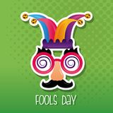 Funny mask jester hat fool day. Dotted green background vector illustration vector illustration
