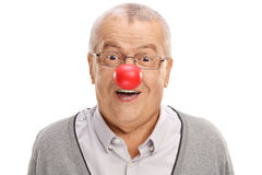 Funny mature man with a clown nose Royalty Free Stock Photo
